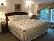 A king Select Comfort bed and two comfortable chairs. This room also offers a very large bathroom with an extra large sink, heated tile bathroom floor, and a combination Roman whirlpool tub and shower with tile surround.